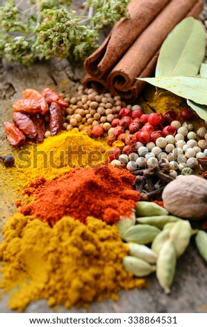Herbs and spices selection, on wooden table background