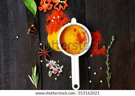 Herbs and spices selection (turmeric, paprika, rosemary, thyme, salt, papper) on dark rustic background. Copy space for text - stock photo