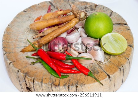 Herbs and spices set on the chopping block to make spicy soup and fried delicious recipes, spicy ingredient in Thailand - stock photo
