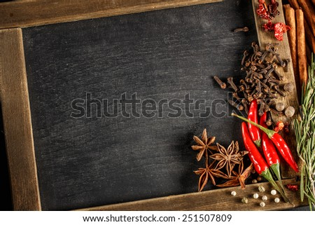 Herbs and spices with chalk board for text or recipes. Top view. - stock photo