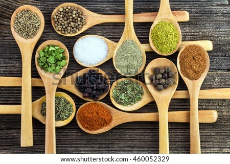 Herbs anHerbs and spices on a wooden boardd spices on a wooden board