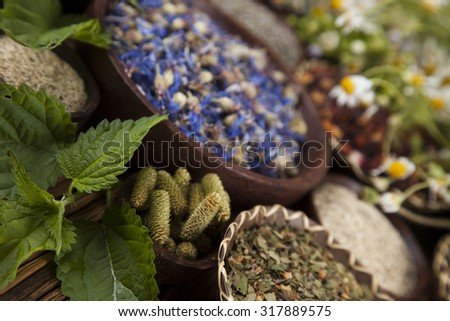 Herbs medicine and vintage wooden background