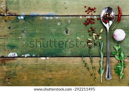 Herbs, spice and garlic on rustic wooden table. Food background with space for text. Health or cooking concept. - stock photo