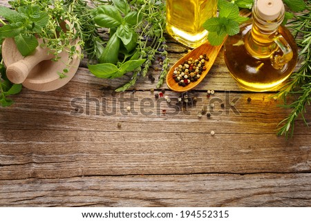 herbs,spice and oil on wooden table - stock photo
