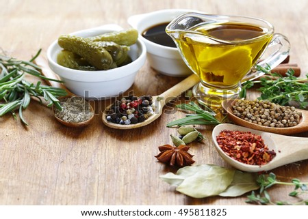 herbs, spices and sauces on wooden background