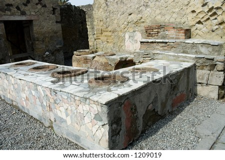 Herculanum Thermopolium or fast foods restaurant,  ruins from the volcano eruption in Herculanum or Ercolano, Naples, Italy,  it had the same use than a fast foods restaurant. - stock photo