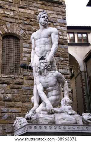 Hercules and Cacus statue in front of Palazzo Vecchio in Florence - stock photo