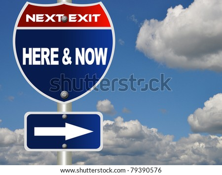 Here and now road sign - stock photo