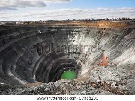 "Here diamonds were extracted. The Mir mine (kimberlite diamond pipe ""World"" or ""Peace"") in city Mirny, Sakha (Yakutia) Republic, Eastern Siberia, Russia - stock photo"