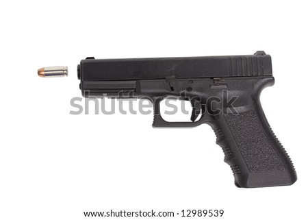 Here is a .40 caliber handgun and police issued hollow point bullet isolated on white background