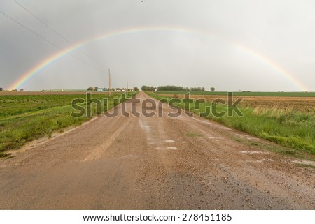 Here is a great country rainbow in Eastern Colorado.   Chase this from a couple different angles.    - stock photo