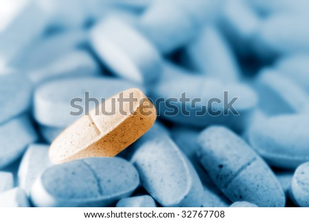 Here is a pill stand out others. - stock photo