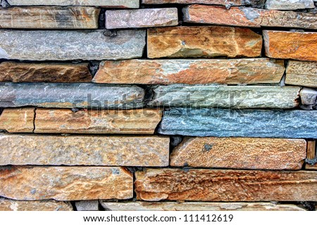 Here is the picture regarding of colorful brick wall. - stock photo