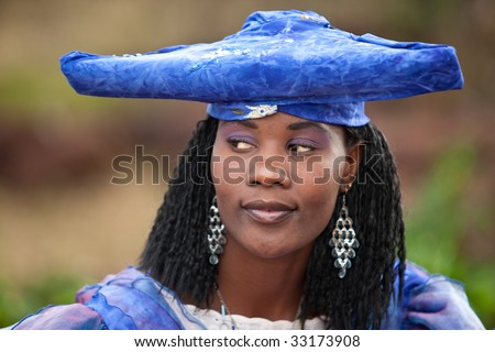 herero african girl with traditional clothing, hairstyle and jewelry, Namibia, South Africa, and Botswana - stock photo