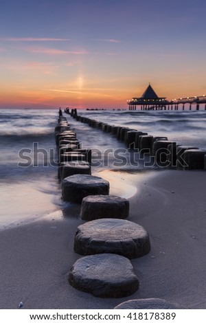 Heringsdorf Pier stretching out into the Baltic Sea, on the island of Usedom; in Germany - stock photo
