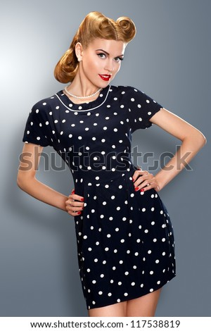 Heritage. Pin-up girl in retro vintage old-fashioned dress in romantic pose. Hipster - stock photo