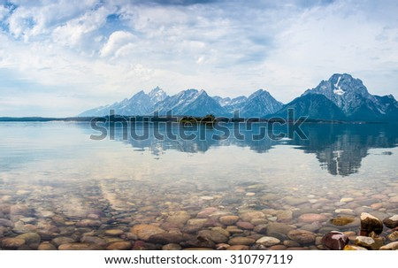Hermitage Point view across Jackson Lake with the Grand Tetons near Moran,  USA., wyoming - stock photo