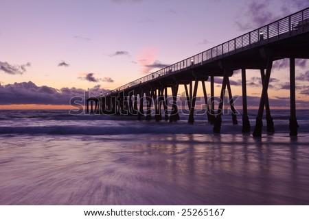 Hermosa Beach pier at sunset. - stock photo