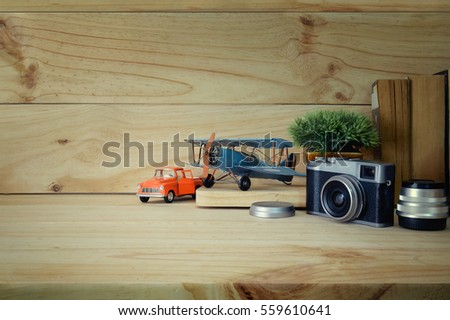 Hero header. Vintage Toy and gadgets on a wooden table background.