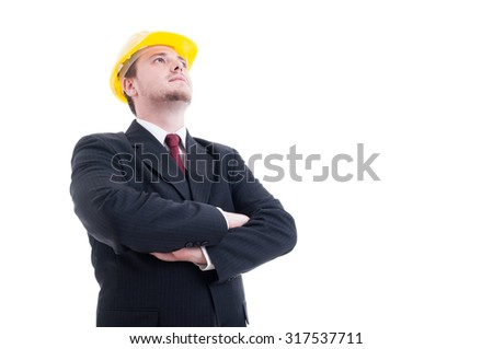 Hero shot of architect or visionary contractor with arms crossed and looking up to the future concept - stock photo