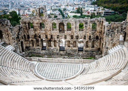 Herodes theater of the Acropolis in Athens with the city of Athens at background   - stock photo