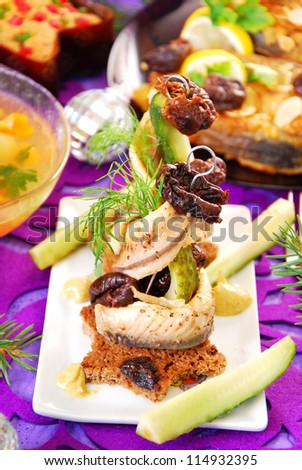 herring appetizer with prune and gherkin on christmas eve`s table - stock photo