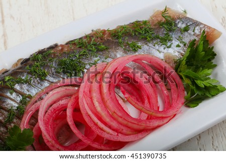 Herring fillet with pickled red onion and dill
