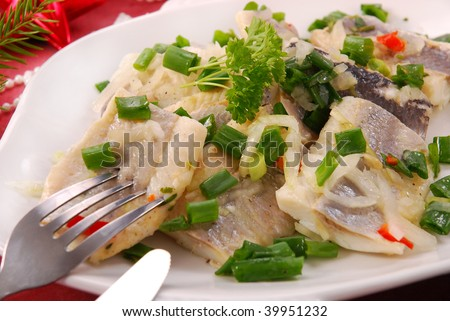 herring in oils with chives and onion for christmas eve - stock photo