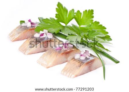 herring isolated pieces of salt fillet with onion - stock photo
