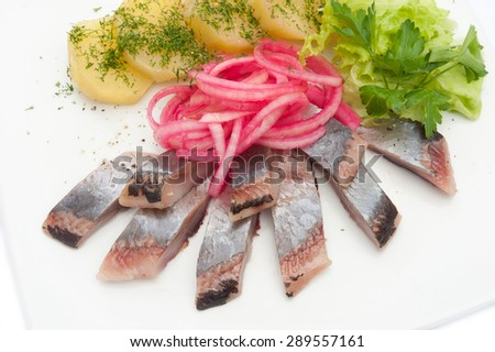 herring salad with potatoes onions and dill - stock photo