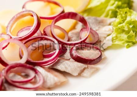 herring with potatoes - stock photo