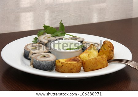 Herring with sauce and potato