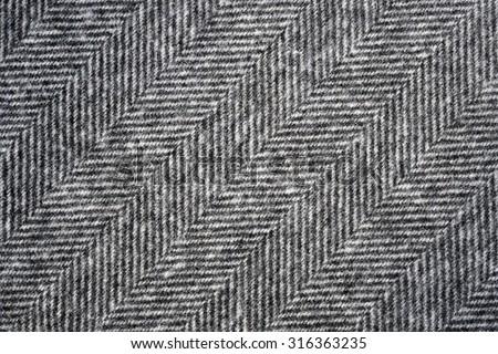 Herringbone tweed background with closeup on wool fabric texture - stock photo