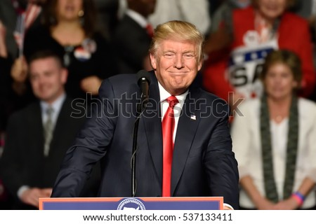 "HERSHEY, PA - DECEMBER 15, 2016: President-Elect Donald Trump smiles as he pauses during a speech at a ""Thank You"" tour rally held at the Giant Center."