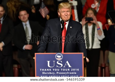 "HERSHEY, PA - DECEMBER 15, 2016: President-Elect Donald Trump smiles during a speech at a ""Thank You"" Tour rally held at the Giant Center. The new USA logo with Make America Great Again is visible."