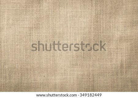 Hessian sackcloth woven texture pattern background in dark cream beige brown color tone: Eco friendly raw organic flax cloth fabric textile backdrop: Bag rope thread detailed textured burlap canvas   - stock photo