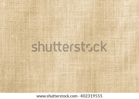 Hessian sackcloth woven texture pattern background in yellow beige cream brown color tone: Eco friendly raw organic flax cloth fabric textile backdrop: Bag rope thread detailed textured burlap canvas - stock photo