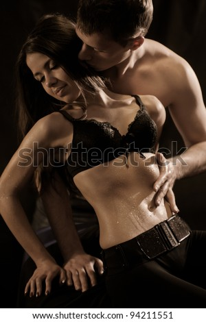 Heterosexual couple enjoying each other. Shallow depth of field - stock photo