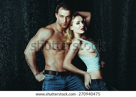 Heterosexual Couple of Attractive Man And Woman Sexualy Wet Posing Under Water