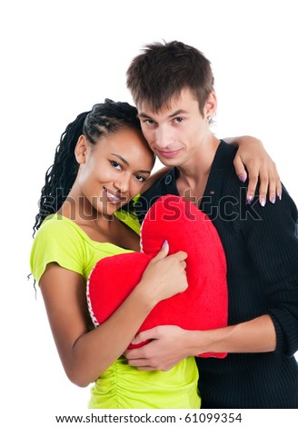Heterosexual couple with a big heart on white background - stock photo