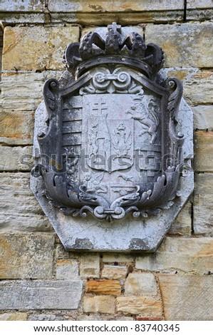 Hever Castle gardens wall emblems - stock photo
