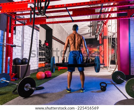 Hex Dead Lift Shrug Bar Deadlifts man at gym workout weightlifting - stock photo