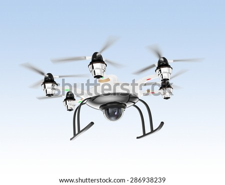Hexacopter drone with security camera hovering in the sky