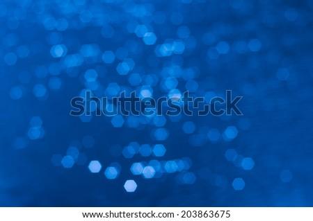 Hexagon bokeh on water surface - stock photo