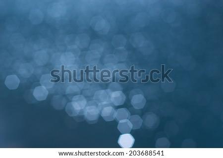 Hexagon boken on water surface - stock photo