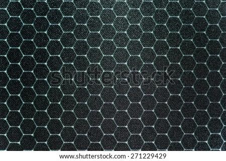 hexagon on fabric - stock photo