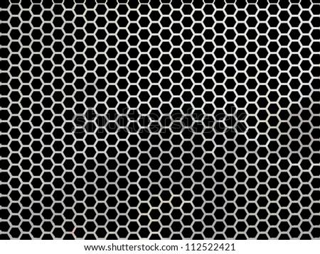 Hexagonal, honey comb stainless steel mesh on black - stock photo