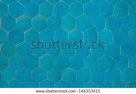 Hexagonal shaped plain blue tiles, creating a ceramic pattern. - stock photo