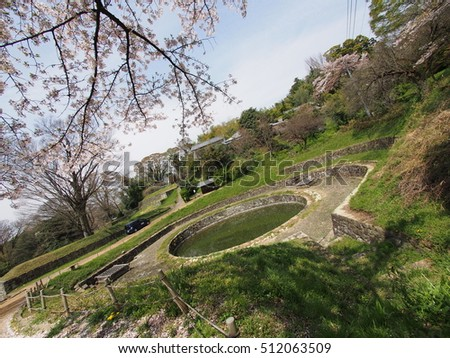 Hi Pond and cherry blossoms in Kanayama-jo Castle in Japan.(Hi means sun in Japanese.)