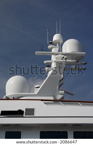 hi-tech antenna array on very upmarket motor yacht - stock photo